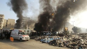 Smoke rises from a bus station hit by what activists said was an airstrike by forces loyal to Syria's President Bashar al-Assad, as garbage fills the street in Jisr al-Hajj in Aleppo
