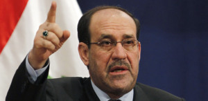 Iraq's Prime Minister Nuri al-Maliki speaks during a conference about national reconciliation at the National Theatre in Baghdad