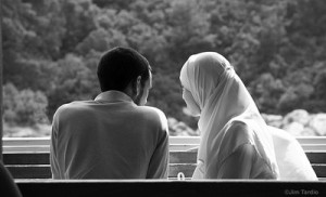 muslim-couple-seated-outside