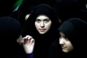 Iranian women attend a ceremony marking