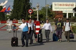 Chinese nationals cross to Cambodia from Vietnam at the Bavet international checkpoint in Svay Rieng province