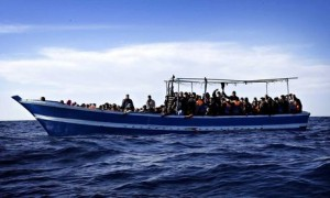 Boat carrying migrants off coast of Libya