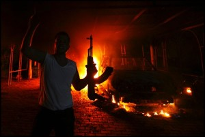 Image: A protester reacts as the U.S. Consulate in Benghazi burns