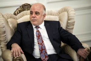 New Iraqi Prime Minister Abadi listens to U.S. Secretary of State Kerry after a meeting in Baghdad