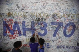 Children write messages of hope for passengers of missing Malaysia Airlines Flight MH370 at Kuala Lumpur International Airport