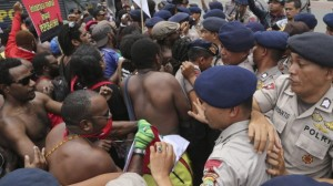 Papuan activists scuffle with police during a rally marking the 53rd anniversary of the Free Papua Movement in Jakarta on December 1. Photo: AP