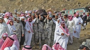 Saudi forces carry the corpse of Sulaiman al-Maliki, the first Saudi soldier killed in cross-border clashes near border with Yemen.