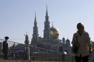 Pedestrian walks near the Moscow Grand Mosque before an opening ceremony in Moscow