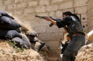 A Jaysh al-Islam (Army of Islam) rebel fighter fires his weapon towards forces loyal to Syria's President Bashar Al-Assad at the Tal-Kurdi frontline in the Eastern Ghouta of Damascus