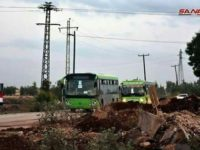 Rombongan bus yang mengangkut para pemberontak bersama keluarga mereka keluar meninggalkan wilayah utara Provinsi Homs.