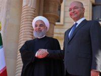 Presiden Iran, Hassan Rouhani (kiri) sedang berjabatan tangan dengan Presiden Irak, Barham Salih. Sumber: Presstv
